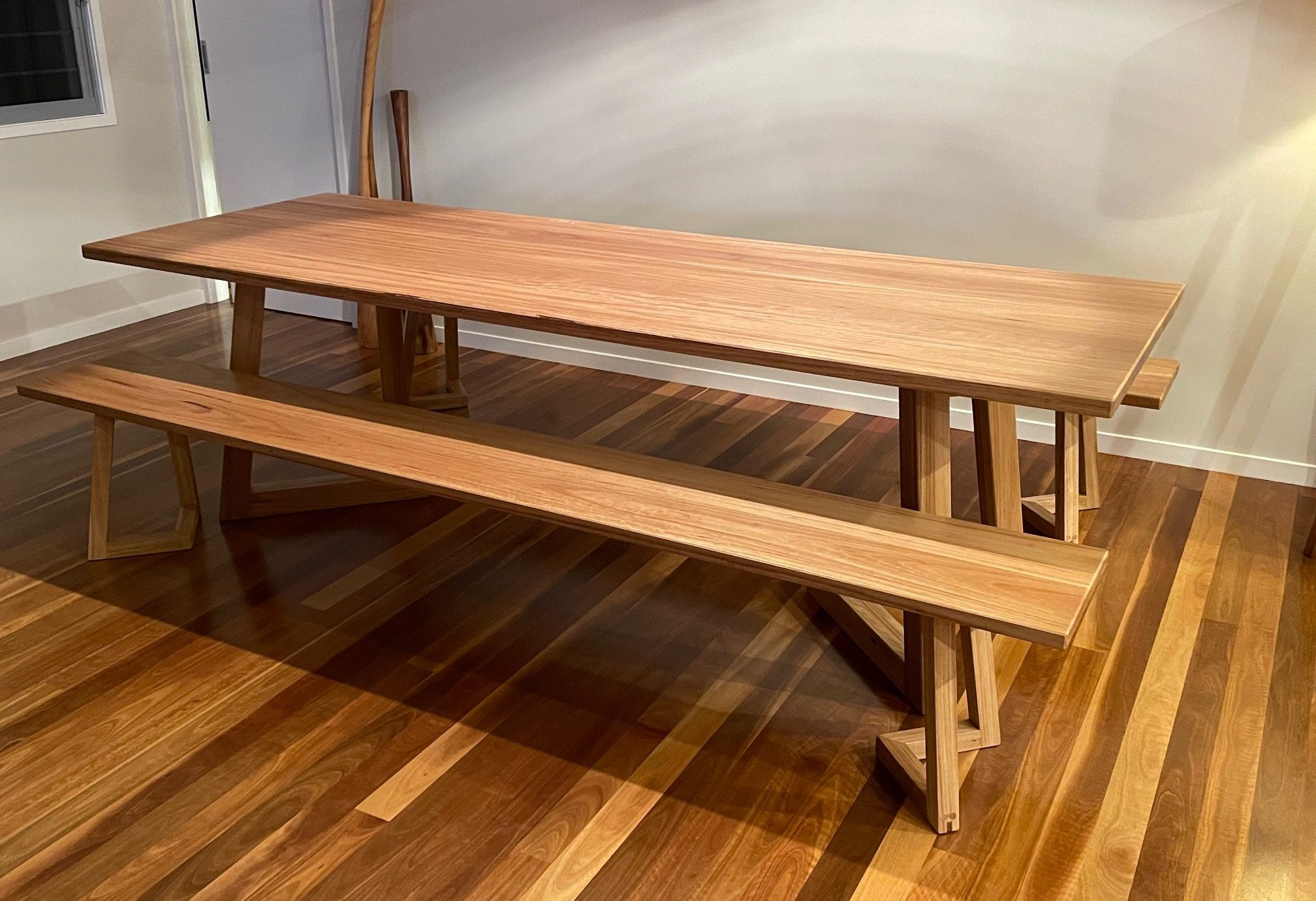 Custom timber dining table with benches